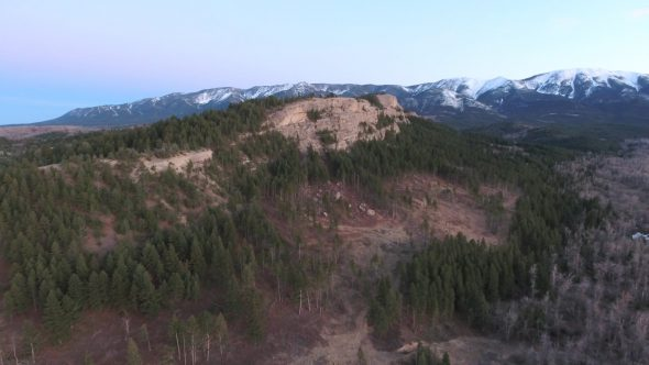 Aerial Drone Footage Zoom Out of Montana Mountain at Sunset Royalty Free Stock Drone Video Footage