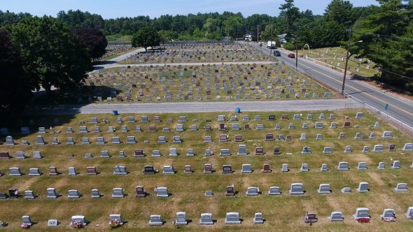 Drone Shot Pans Backwards Over Small Town U.S. Cemetery Royalty Free Stock Drone Video Footage