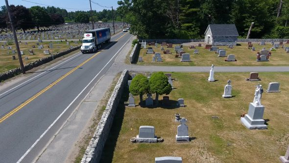 Aerial Drone Shot of Small Town U.S. Cemetery Pans Right Royalty Free Stock Drone Video Footage
