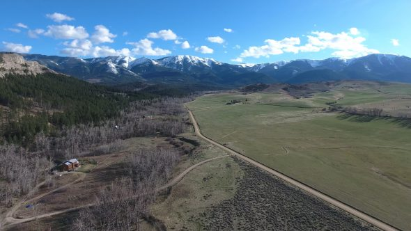 Aerial Drone Video of Montana Mountains and Blue Skies