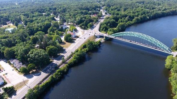 Aerial Drone Footage Looking Down on Merrimack River and Tyngsborough Bridge