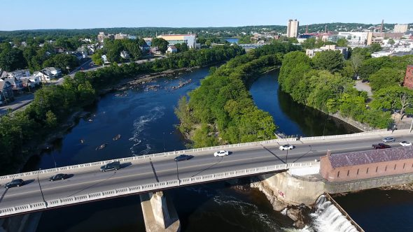 Aerial Drone Video Footage of Suburban River, Waterfall and Bridge