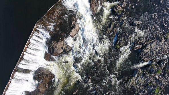 Straight Down Aerial Drone Video Footage of Suburban River and Small Rocky Waterfall 1