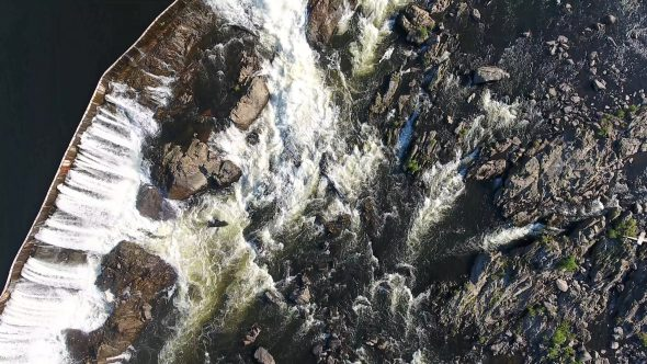 Straight Down Aerial Drone Video Footage of Suburban River and Small Rocky Waterfall 2