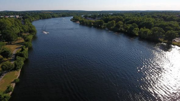 Aerial Drone Video of Jet Skis on A River Pan In