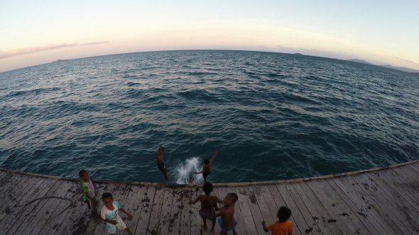 Papua Village Kids Dock 9 Royalty Free Stock Drone Video Footage