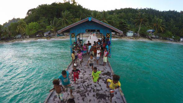 Papua Village Kids Dock 6 Royalty Free Stock Drone Video Footage