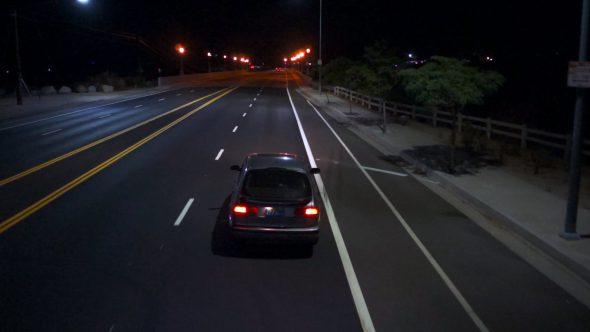 Car Driving Over Bridge At Night