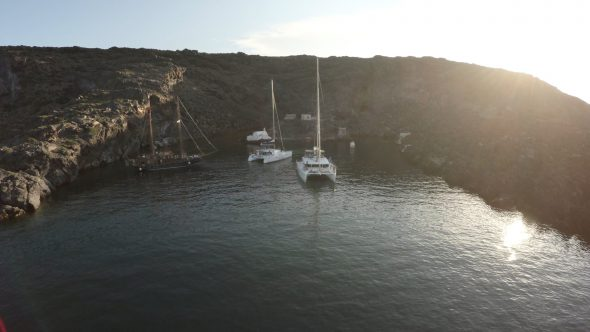 Santorini Sail Boat Fly By Royalty Free Stock Drone Video Footage