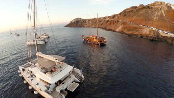 Santorini Catamaran Fly By Royalty Free Stock Drone Video Footage