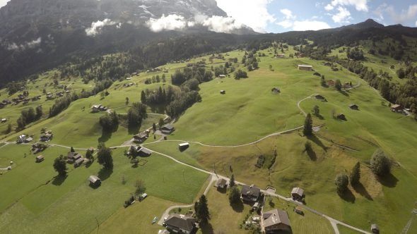 Swiss Farm Zoom Out Royalty Free Stock Drone Video Footage