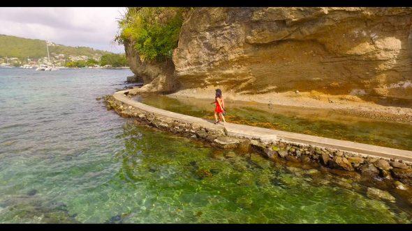 Ladies on Seawalk in Bequia 2 Royalty Free Stock Drone Video Footage