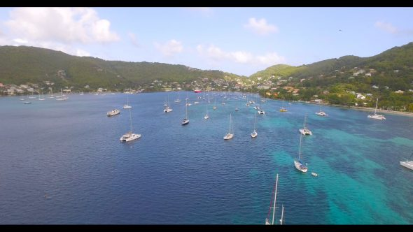 Sailboats in Harbor Bequia 2 Royalty Free Stock Drone Video Footage