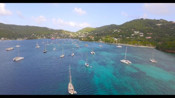 Sailboats in Harbor Bequia 3 Royalty Free Stock Drone Video Footage