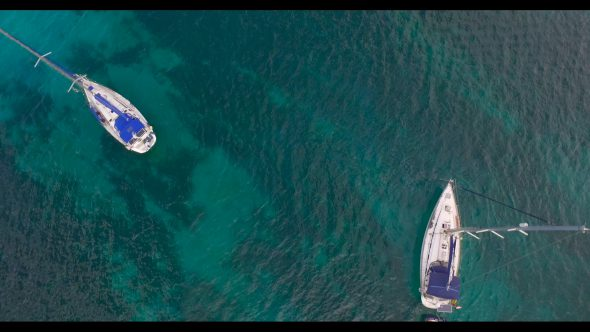 Looking Down at Sailboats Royalty Free Stock Drone Video Footage