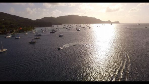 Motorboat in Harbor with Sailboats Bequia Royalty Free Stock Drone Video Footage