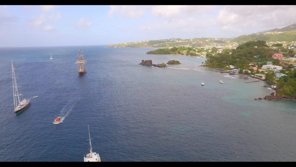 Sailboats and a Motorboat on Deep Blue Waters Royalty Free Stock Drone Video Footage
