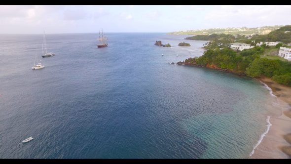Landing View of a Coastline with Sailboats Royalty Free Stock Drone Video Footage