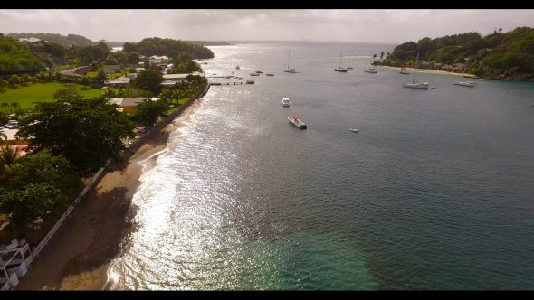 Rising Above a Lagoon with Anchored Sailboats Royalty Free Stock Drone Video Footage