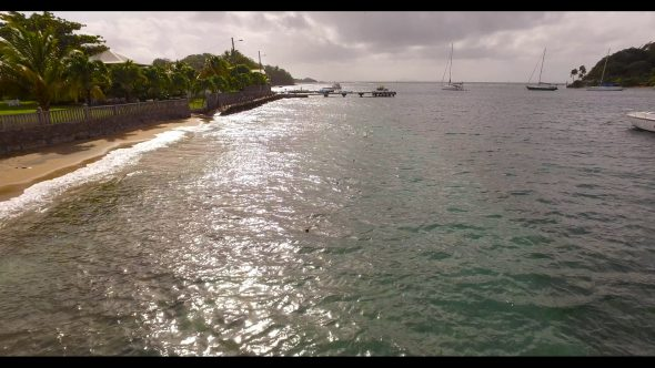 Zoom Out of The Lagoon with Anchored Sailboats Royalty Free Stock Drone Video Footage