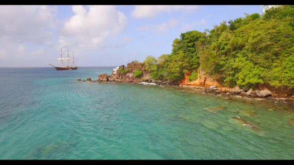 A Sailboat on Clear Blue Waters Royalty Free Stock Drone Video Footage