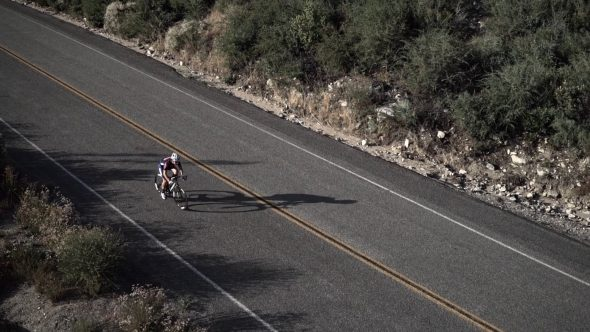 Mountainside Cyclist 1 Royalty Free Stock Drone Video Footage