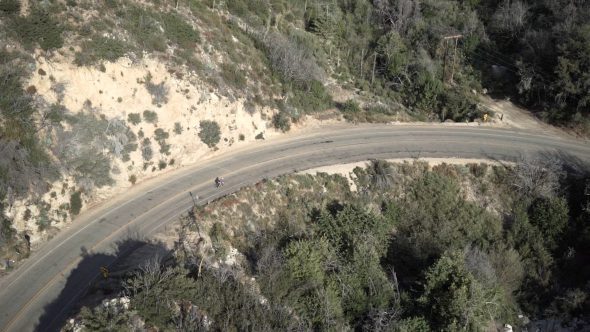 Mountainside Cyclist 2 Royalty Free Stock Drone Video Footage