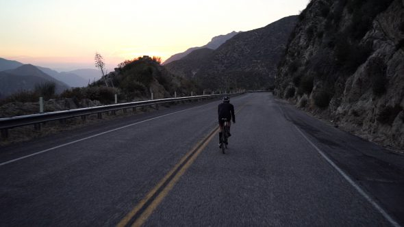 Mountainside Cyclist 6 Royalty Free Stock Drone Video Footage