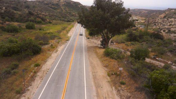 Car Driving Down Road 1