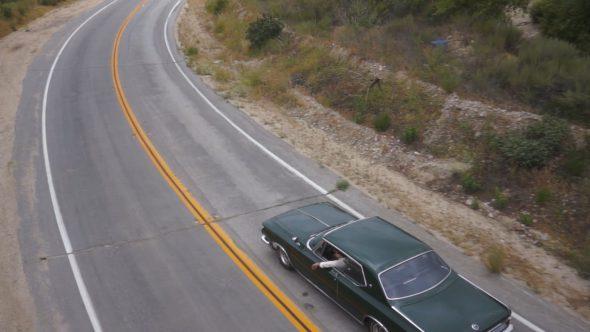 Car Driving Off Pan Up