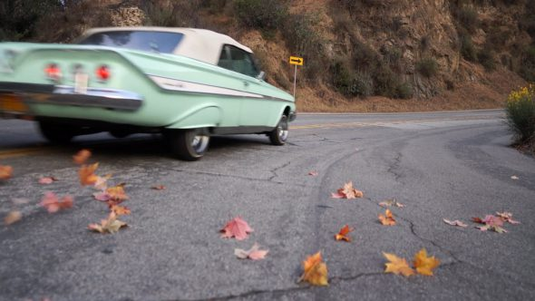 Car Blowing Leaves Glide Royalty Free Stock Drone Video Footage