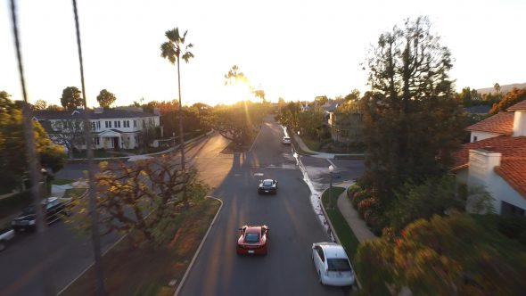McLarens Suburban Sunset Chase 1 Royalty Free Stock Drone Video Footage