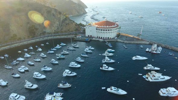 Yachts and the Sta. Catalina Island Casino 2 Royalty Free Stock Drone Video Footage