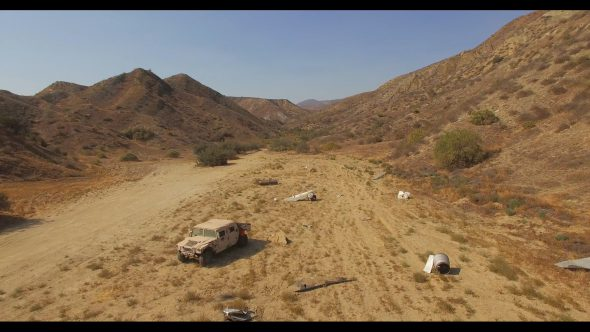 Desert humvee 1 Royalty Free Stock Drone Video Footage