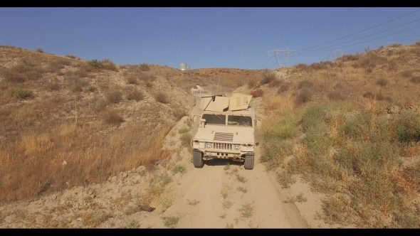 Desert humvees and Truck Convoy 1 Royalty Free Stock Drone Video Footage