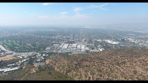Overlooking Warner Bros. Studios in Burbank California Forward 1 Royalty Free Stock Drone Video Footage