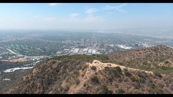 Overlooking Warner Bros. Studios in Burbank California Reverse Royalty Free Stock Drone Video Footage