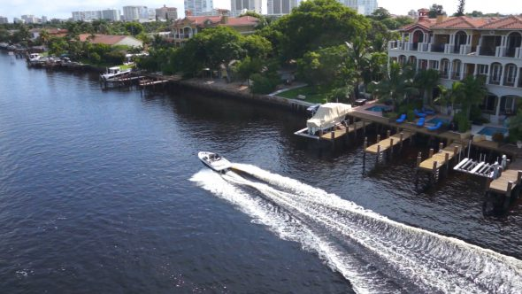 Reveal Boat Going Down River Royalty Free Stock Drone Video Footage