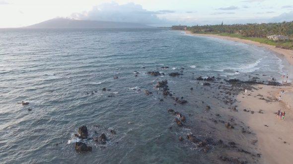 Maui Rocky Beach Forward Glide 2 Royalty Free Stock Drone Video Footage