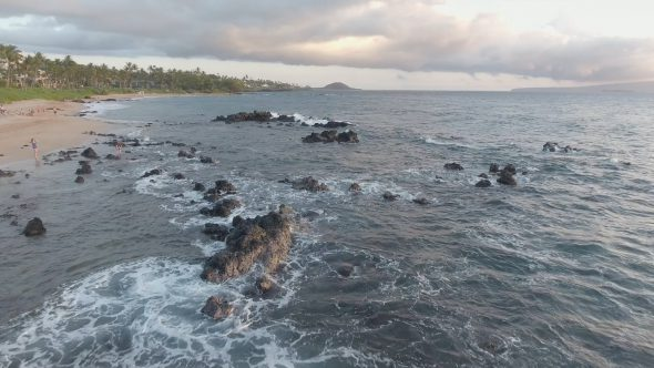 Maui Rocky Beach Low Forward Glide Royalty Free Stock Drone Video Footage