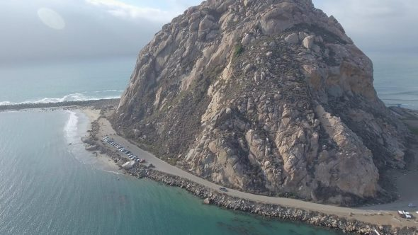Panoramic View and Shadow of the Great Morro Rock Royalty Free Stock Drone Video Footage