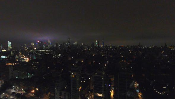 Aerial Drone Shot Backward Pan Away from NYC at Night