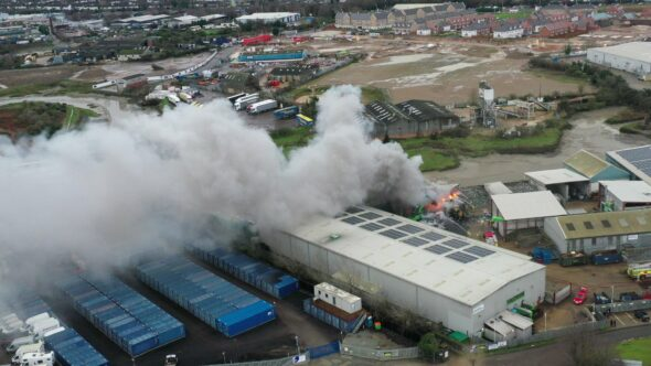 Scrap metal fire at a recycling facility Royalty Free Stock Drone Video Footage